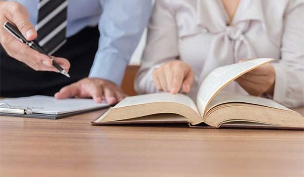 8-couple-checking-a-book-600x350